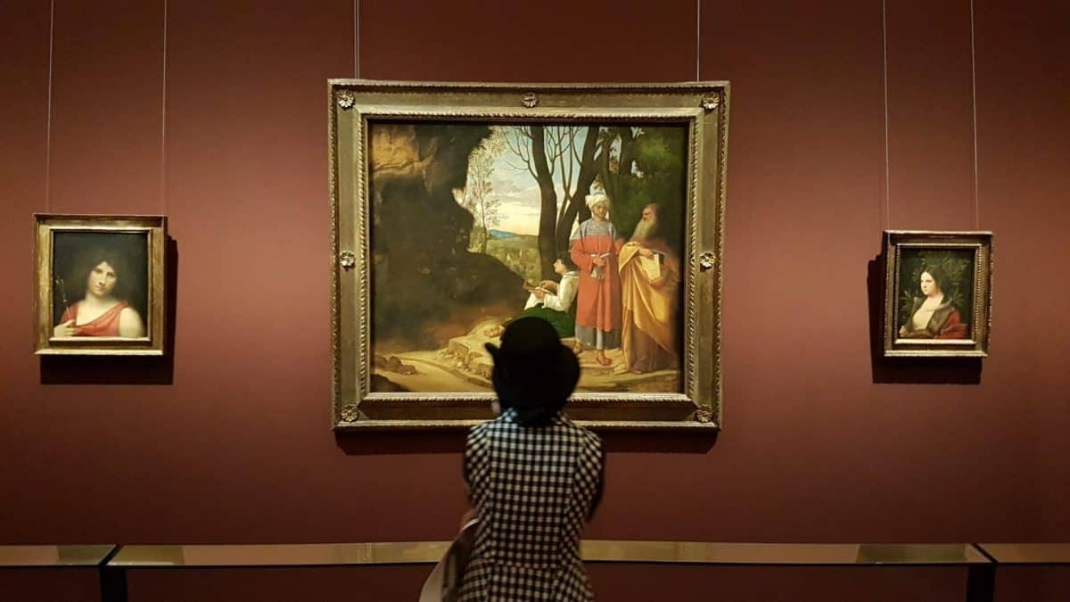 A viewer in front of Giorgione's painting. Photo: Art with me! e.U., 2019