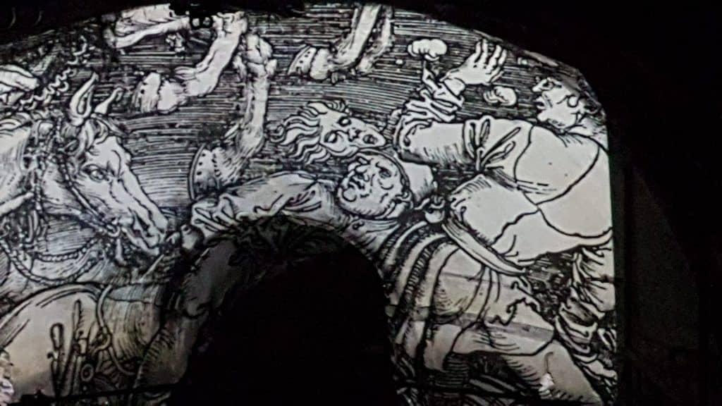 """Проекция """"Четырех всадников Апокалипсиса Дюрера в канализации Вены. Фото Юлии Абрамовой., 2019"""