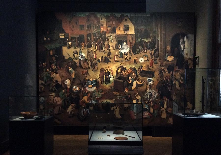 """Macrophotograph """"The Fight Between Carnival and Lent"""" and artifacts from various historical collections, the images of which are found in this painting. Photo: Art with me! e.U., 2019"""